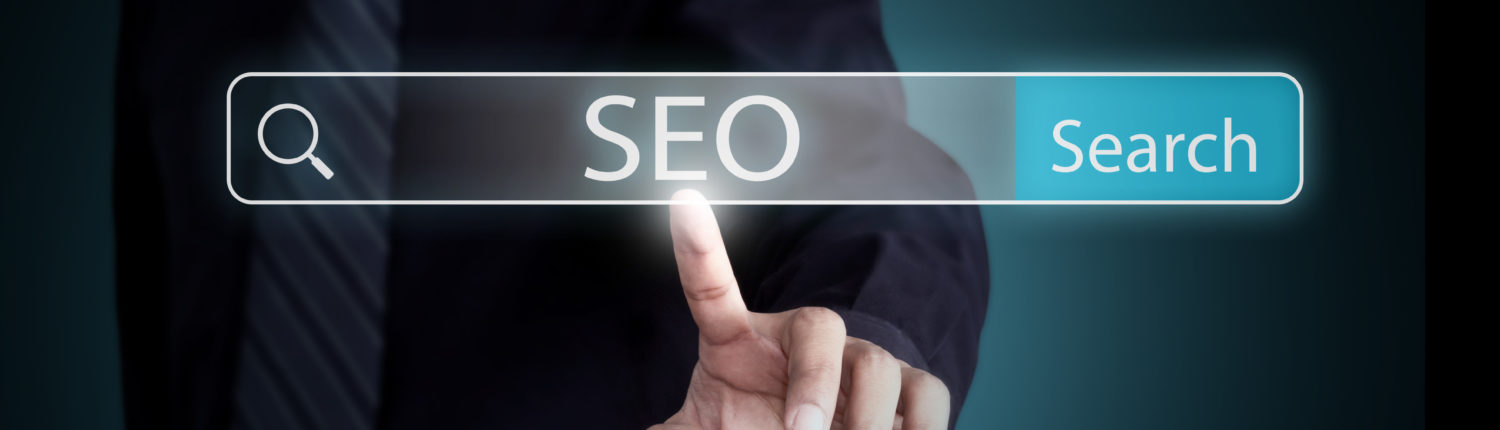A picture of a man's finger searching for SEO